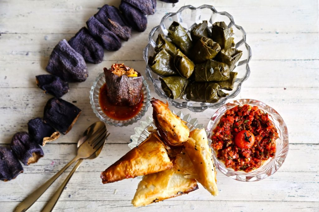 meze, supper club table, ezme, dolmades, filo triangles, dried aubergines, dolmas in tomato saffron sauce
