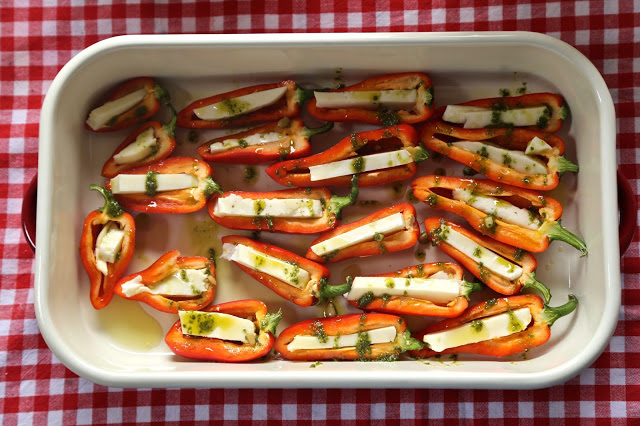 Baby peppers stuffed with halloumi and a pesto glaze recipe