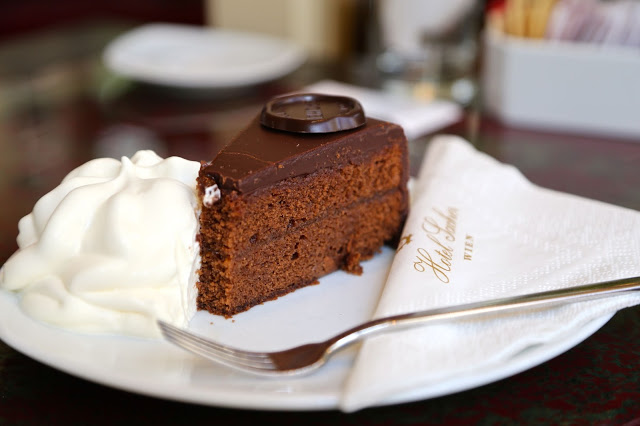 sachertorte cake with whipped cream, cafe sacher, vienna