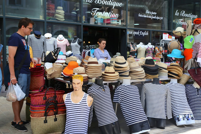Selling boaters and striped tshirts at Sète market, South of France