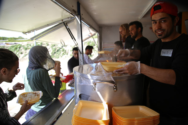 Serving food, dunkirk community kitchen for refugees