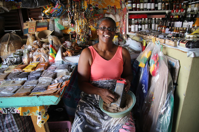 spice seller in St Georges market, grenada