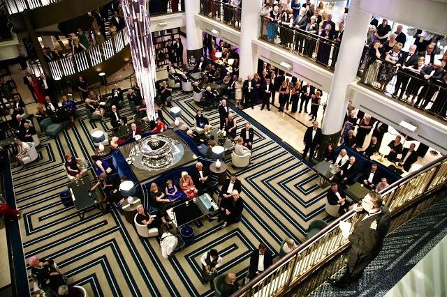 The Captain speaking. The Atrium.  Britannia, P and O cruise ship. pic: Kerstin Rodgers/msmarmitelover