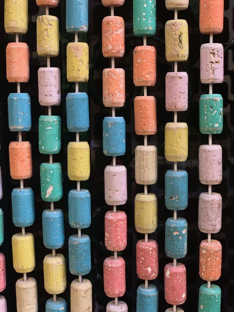 pastel cork curtain to keep out flies, Bosa, Sardinia pic: Kerstin rodgers/msmarmitelover.com