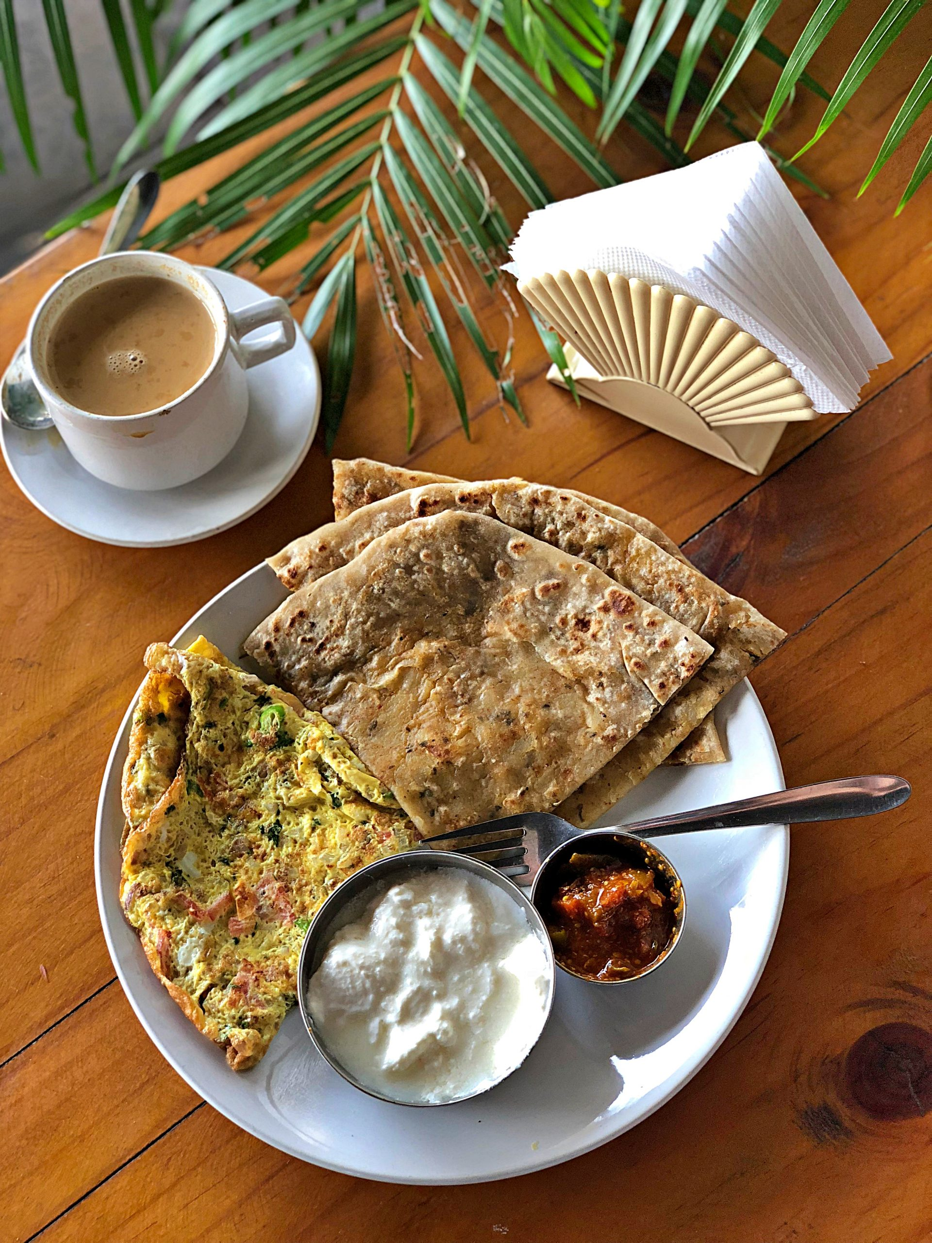 Indian masala omelette served with chai, yoghurt, paratha and chutney pic: Kerstin rodgers/msmarmitelover.com